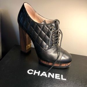 Chanel black quilted leather lace up booties